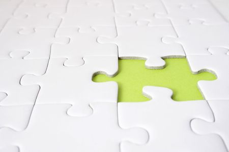 conceptions: A single green gap in a plain white puzzle game. Stock Photo