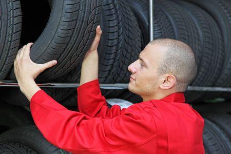 working hard: A mechanist working hard in a tire workshop.