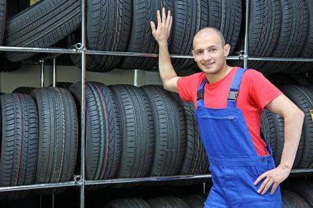 stocktaking: A trustful worker in a tire workshop ** Note: Slight blurriness, best at smaller sizes.