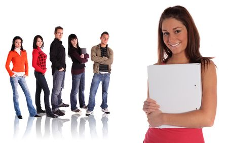 motivated: An ambitious student standing in front of a group of other students. All isolated on white background. Stock Photo