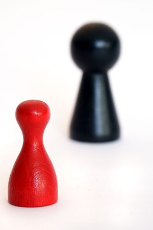 david and goliath: A small red figure against a huge black one. All on light background. Stock Photo