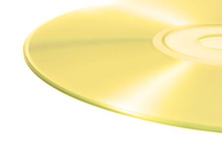 informational: A closeup view of a light shiny compact disk used for data storage on a white background.
