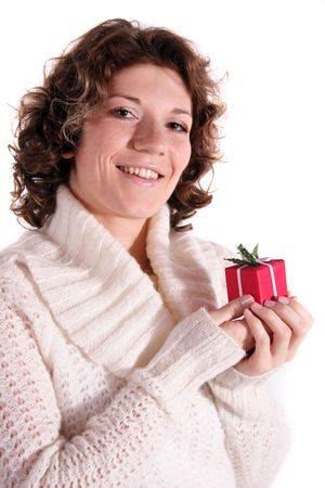 A handsome young woman holding a small red presents. All isolated on white background. photo