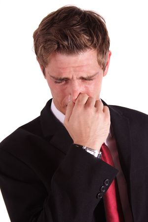 the stinking: A handsome businessman smells something stinky. All isolated on white background. Stock Photo