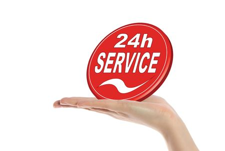 24: A neat human hand holding a stylized sign that offers a 24 hour service. All isolated on white background.