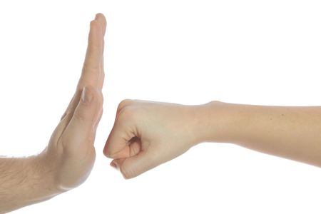 absorb: A human hand punching another hand. All isolated on white background.
