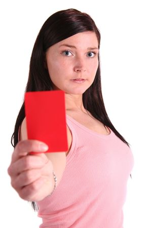 A handsome young woman shows someone a redcard. All isolated on white background. photo