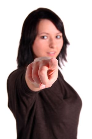 sanguine: A handsome young woman points with her finger at someone or something. All isolated on white background.