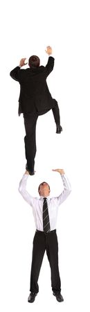 metapher: Two young business men climbing upwards. All isolated on white background.