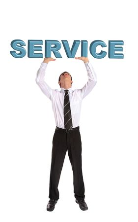 A young businessman lifting up the word service. All isolated on white background.