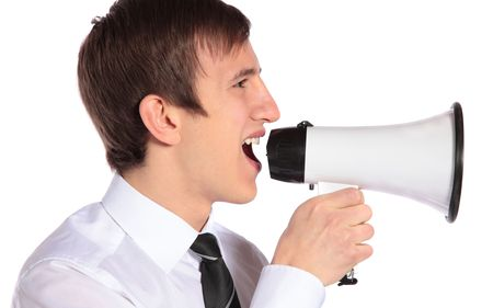 A young businessman using a megaphone. All isolated on white background. Stock Photo - 6518553