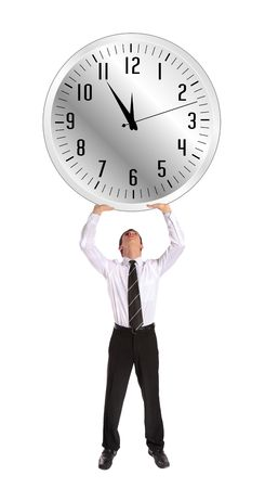 A young businessman stemming a huge clock that shows the elventh hour. photo