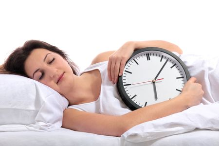 A young woman sleeping with a clock in her arms. All on white background. Stock Photo - 6601794