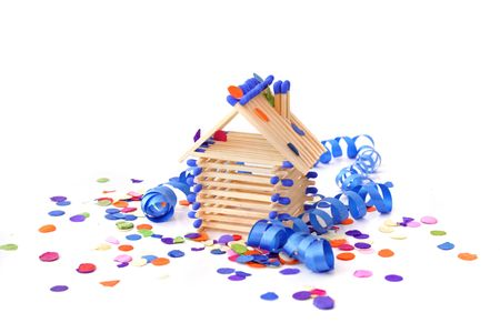 tinkered: A tinkered house within confetti and streamers. All isolated on white background.
