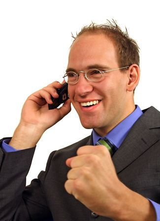 A smart businessman gets a surprising telephone call. All isolated on white background. Stock Photo - 6601814