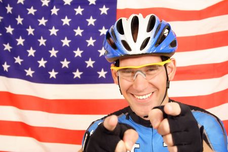sanguine: An US pro cyclist in optimistic mood in front of the flag of the United States of America. Stock Photo