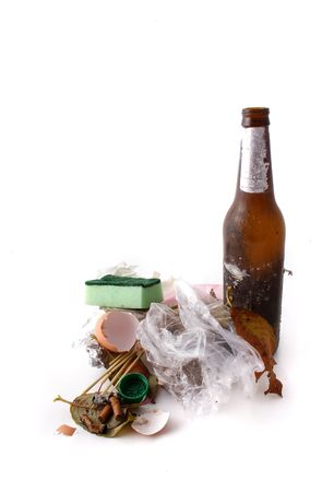smut: A dirty pile of trash lying in front of white background. Stock Photo