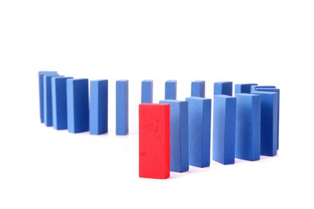 interdependence: A line of blue dominoes with a single red block at first position. All isolated on white background.