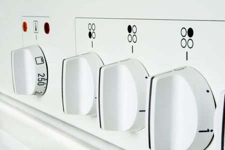 Closeup of a modern stove in light white color. photo