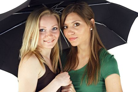sheltering: Two girlfriends sheltering under an umbrella. All isolated on white background.
