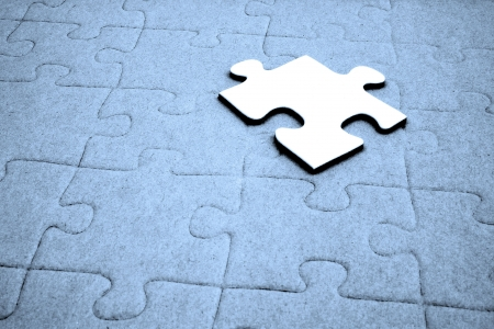 in need of space: A typical jigsaw puzzle with a single piece on top. Stock Photo