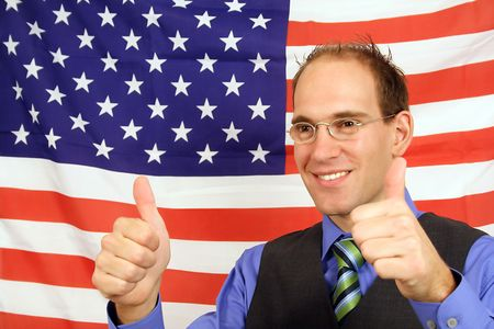jubilation: A young businessman jubilation in front of the flag of the United States of America.