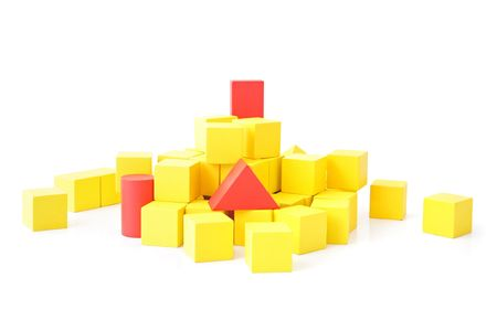salience: Single red blocks in a pile of yellow ones. All isolated on white background.