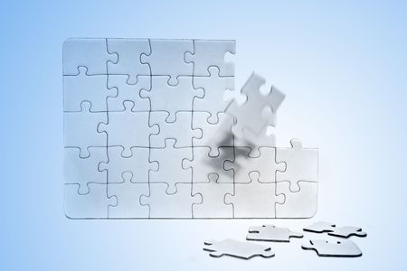 conceptions: A jigsaw puzzle with various missing pieces. All in front of light blue background.