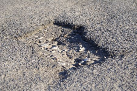 ruinous: Showing a road hole. Stock Photo