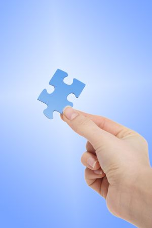 conceptions: A person holding a blue piece of a puzzle in his hand. All on light blue background.