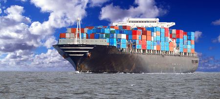 forwarder: A loaded containership navigates across the ocean. Stock Photo