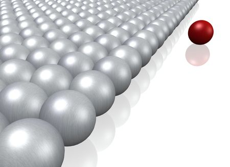 A single red ball lying next to a crowd of grey balls. photo