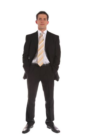 An ambitious businessman standing in front of a white background. Stock Photo - 6813403