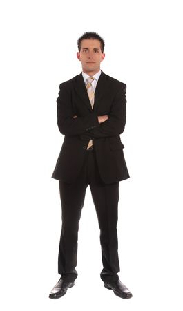 An aspiring businessman standing in front of a plain white background.  Stock Photo - 6813369