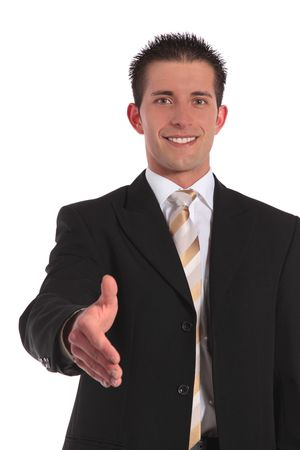A handsome businessman reaches out his hand. All on white background. Stock Photo - 6813365