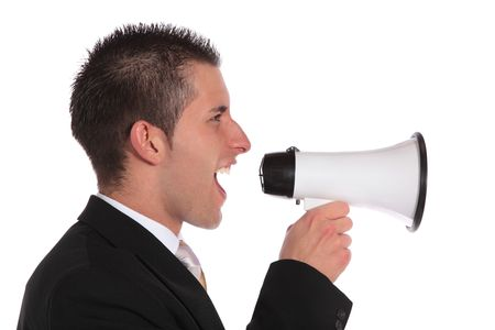 A handsome businessman using a megaphone. All on white background. photo