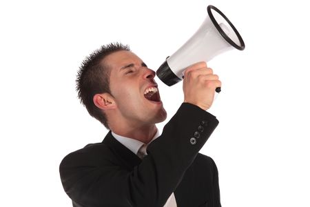 businessman using a megaphone: A handsome businessman using a megaphone. All on white background.