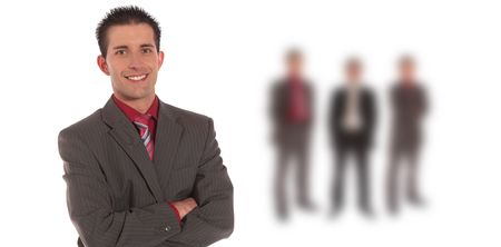 A handsome businessman standing in front of a group of businessmen. All on white background. photo