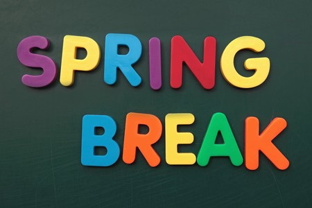bold: Several bold multicolored letters build the term spring break on a blackboard.