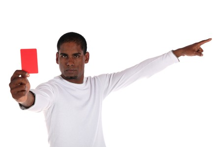 An attractive dark-skinned man showing the red card. All on white background. photo