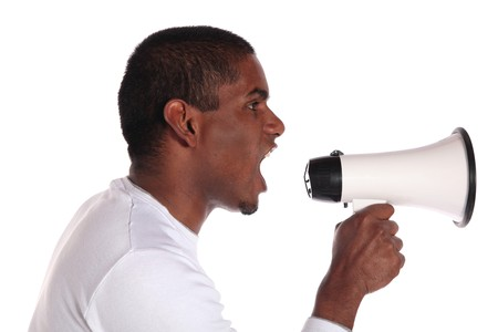 dusky: An attractive dark-skinned man using a megaphone. All on white background.