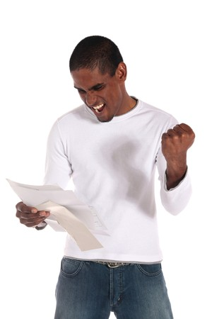 jubilating: An attractive dark-skinned man getting good news via mail. All on white background. Stock Photo
