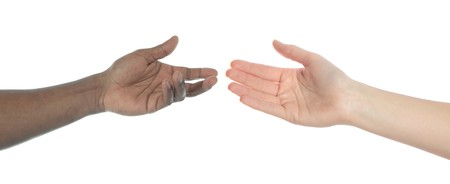 Two persons of different skin color reaching hands. All on white background. photo