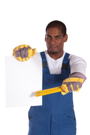 An attractive dark-skinned worker pointing at a blank sheet of paper. All on white background. Sheet kept blank for individual text. photo