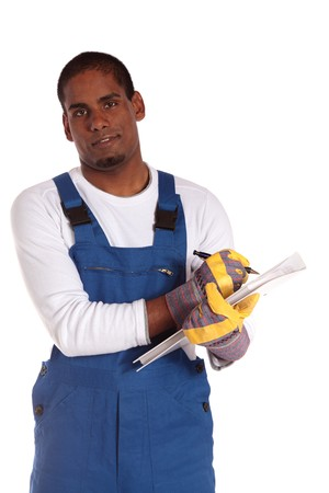 A motivated dark-skinned worker during stocktaking. All on white background. photo
