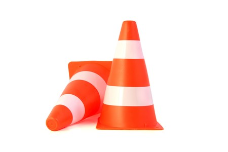 Two orange traffice cones. All on white background.  photo