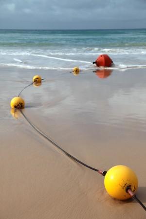 buoys: Buoys at the beach Stock Photo