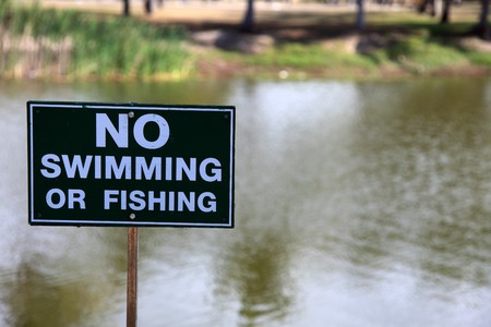 No swimming or fishing in this pond Stock Photo - 7849043