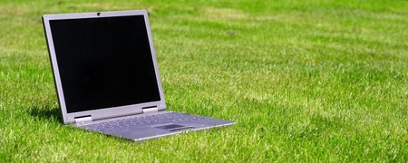 Notebook computer lying on green grass Stock Photo - 7863644