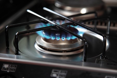 kitchen detail: Typical blue gas flame of a gas stove.